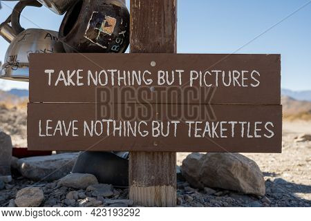 Take Nohting But Pictures Sign At Teakettle Junction In Death Valley National Park