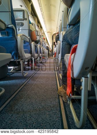 Aircraft Cabin Interior,aisle Of Airplane,back View Of Passenger Seats With Monitor Screen.aeroflot,