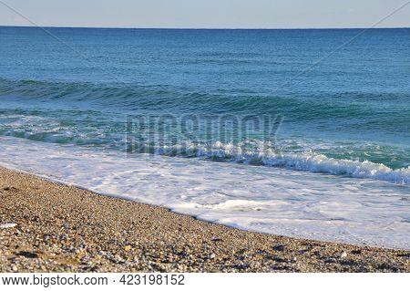 Foamy Wave On A Sandy Beach In Turkey, Horizon, Bright Sea Background, April, 2021