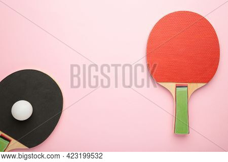 Ping Pong Rackets And Ball On Pink Background. Top View