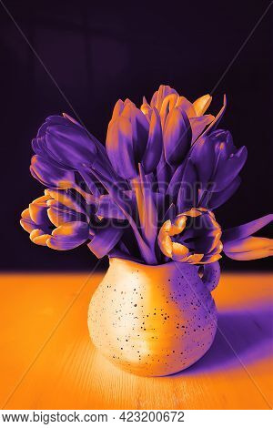 Mystical Duotone Composition With Tulips In A Jug On A Black Background With Moonlight. Halloween Mo