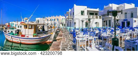 Greece travel. Cyclades, Paros island. Charming fishing village Naousa. view of port with street bars and restaurants (taverns) by the sea.