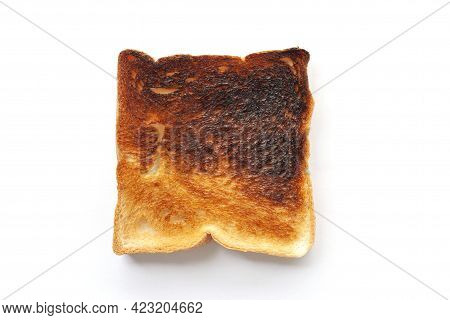 Top View Of Burnt Toast Isolated On White Background.
