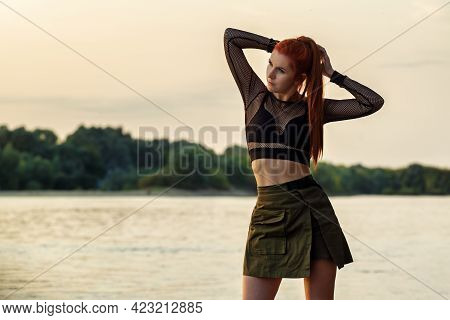Outdoor Portrait Beautiful Sexy Redhair Girl Posing On The Beach Of Riverbank