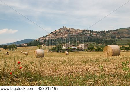Panoramic View Of Trevi Medieval Village With Hay Balls In The Summer Season, Umbria, Italy