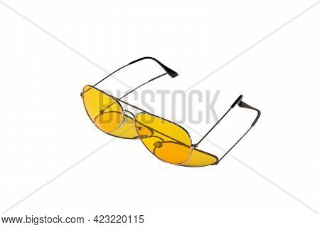 Yellow Sunglasses Isolated On A White Background. Hard Shadows From The Sun At Noon. Leisure, Travel