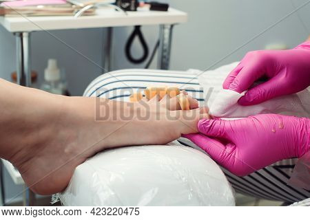 Woman Having Pedicure At Salon. Pedicure And Foot Care Treatment. Female Relaxing At Salon, Caring A