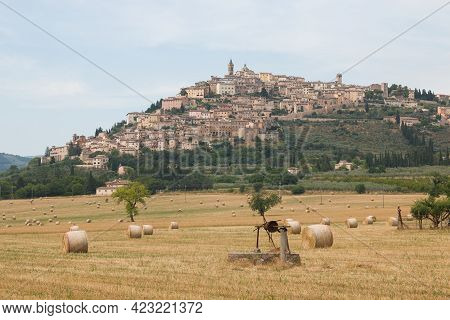 View Of Trevi, The Awesome Medieval City In Umbria Region, Central Italy, During The Summer With Hay