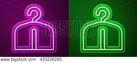 Glowing Neon Line Hanger Wardrobe Icon Isolated On Purple And Green Background. Cloakroom Icon. Clot