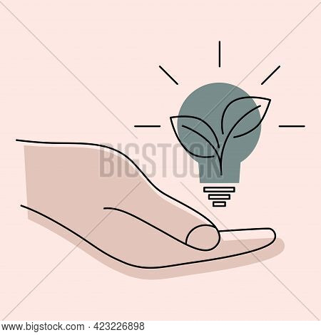 Light Bulb In The Hand. Creative Problem Solving. Hand Holds Green Ecology Light Bulb And Green Plan