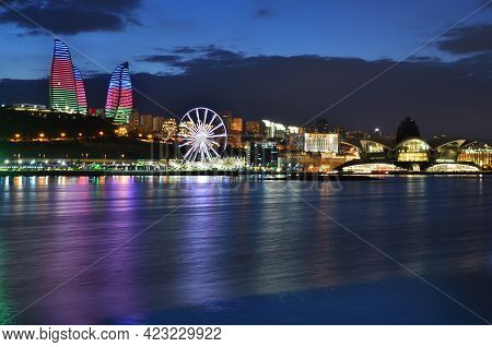 Panorama Of Ferris Wheel, Shopping Entertainment Center And Hote