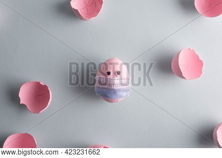 Coronavirus Easter Egg In A Protective Mask Concept Painted In A Pink-blue Pastel Shade Eggshell. Mi