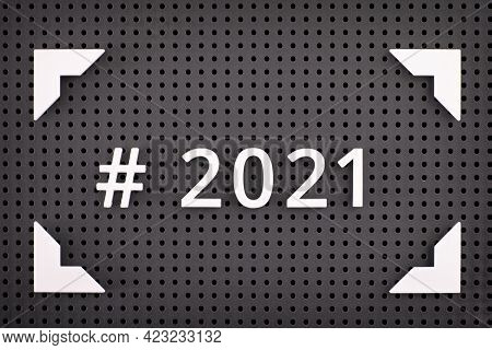 The Hashtag 2021 Spelled Out With White Numbers In A Frame On A Gray Pegboard