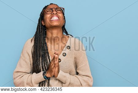 African american woman wearing casual clothes begging and praying with hands together with hope expression on face very emotional and worried. begging.