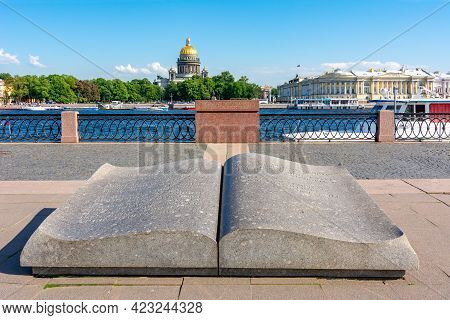 Saint Petersburg, Russia - June 2021: Open Book Monument On University Embankment With St. Isaac's C