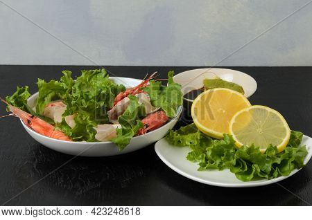 Natural Raw Scallop With Boiled Shrimp In The Sink In A Ceramic Bowl With Lettuce Leaves And Sauce O