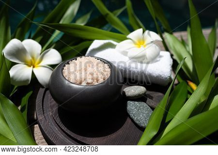 Spa Treatments On Wooden Background Top View. Spa And Beauty Treatment. Body Care With Hot Stones An