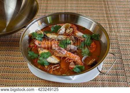 Traditional Portuguese Seafood Dish Cataplana. The Main Ingredients Are Sea Shellfish, Shrimp And Gr