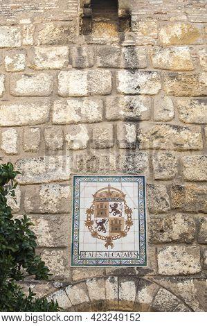 Seville, Spain - Sept 27th 2020: Royal Alcazars Of Seville. Coat Of Arms Glazed Tiled
