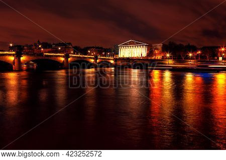 Night View Of Palais Bourbon . Paris In The Nighttime . Seine River With Reflection Of Street Lights