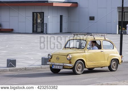 Old Timer Car Zastava Fiat 500 On Street With Driver Inside Passing On Street In Sarajevo, Bosnia An