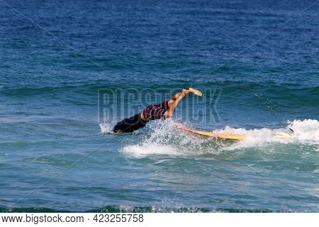 Surfer Riding A Special Board On Big Waves In The Mediterranean Sea