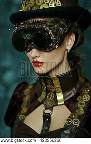 Portrait of a beautiful victorian steampunk lady on a vintage  background. Fantasy world, scientific inventions.