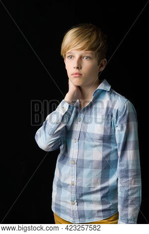Portrait Of Attractive Blond Teenage Boy. Handsome Boy With Stylish Haircut Wearing Plaid Shirt Posi
