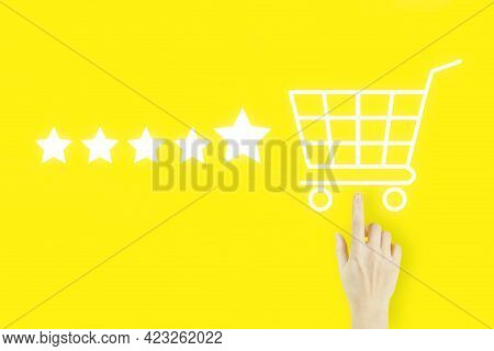 Customer Service Evaluation Concept. Young Woman's Hand Finger Pointing With Hologram Shopping Cart