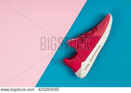 Running Sports Shoe On Blue And Pink Background. Running Shoe, Sneaker Or Trainer. Women's Athletic