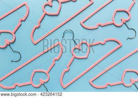 Black Friday Or Clothing Industry Concept On Blue Background Flat Lay With Randomly Scattered Pink C