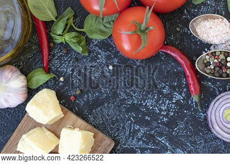Dry Penne With Vegetables, Herbs, Cheese, Mix Pepper, And Pink Salt On A Wooden Table. Uncooked Past