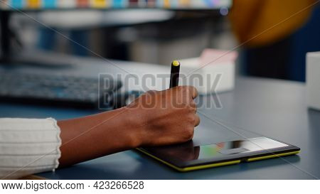 Close Up On Hand Of African Photo Editor Drawing On Graphic Tablet Editing Customer Photo On Compute