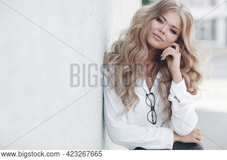 Fashion Sensual Woman Portrait. Outdoor Photo Of Attractive Blonde Model In A White Shirt. Gorgeous