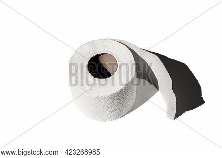 Roll Of A Toilet Paper Isolated On A White Background Close-up. Hard Shadows From The Sun At Noon