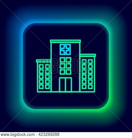 Glowing Neon Line Medical Hospital Building With Cross Icon Isolated On Black Background. Medical Ce