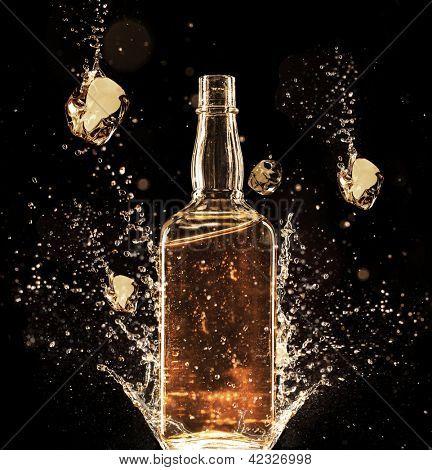 Concept of liquor splashing around bottle, isolated on black background