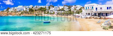 Greece holidays, Cyclades, Paros island beaches and sea. Scenic tranquil coastal village Piso Livadi with turquoise sea and taverns by the sea