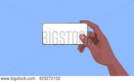 African American Human Hand Holding Smartphone With Blank Touch Screen Using Mobile Phone Concept