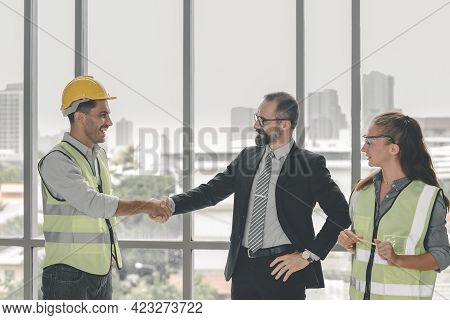 Construction Manager And Engineer Construction In Protective Uniform Shaking Hands While Working Fin
