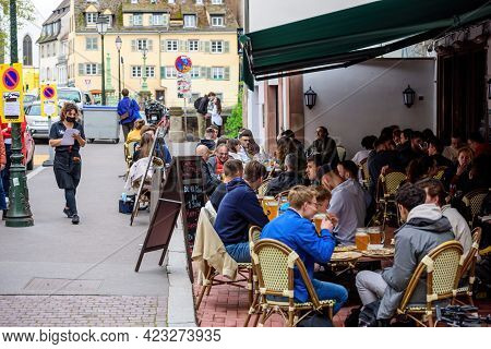 Strasbourg, France - May 19, 2021: Side View Of Young People Eating Drinking At The Terrace Of Le Br