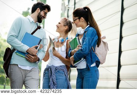Group Of Happy Students Studying, Preparing Together For Exam Ourdoor