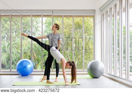 Caucasian Woman Sitting And Balancing With Trainer. Fitness, Sport, Training And People Concept