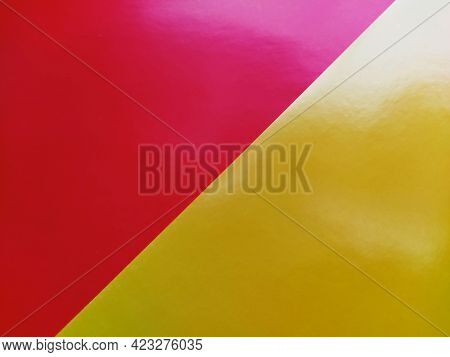 Yellow-pink Bright Background. Diagonally Laid Sheets Of Colored Paper With A Gradient And Light Fla