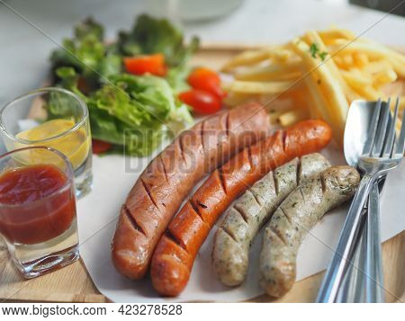 Various Flavors Of Pork Sausages On Wooden Tray With Mayonnaise And Tomato Sauce In Clear Glass, Foo