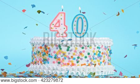 Colorful tasty birthday cake with candles shaped like the number 40.