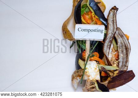 Organic Food Waste. Paper Bag With Vegetable Leftovers For Compost Top View. Recycle Concept. Organi