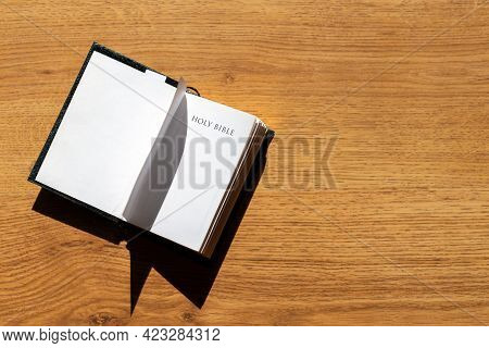 Open Holy Bible On A Brown Wooden Table.open Holy Bible Top View.religious Concept.
