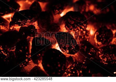 Glowing Hot Charcoal Briquettes on garden grill