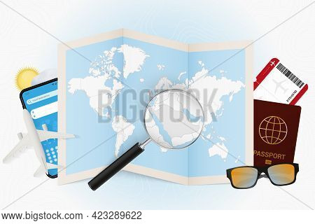 Travel Destination Saudi Arabia, Tourism Mockup With Travel Equipment And World Map With Magnifying